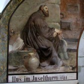 In what used to be a monastery, there is a painting of Jan Hus, the Czech Reformer, being held in prison in Constance, Germany, awaiting trial.