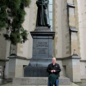 Standing in front of a statue of Zwingli.