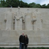Lisa and I standing in front of the statues of Beza, Calvin, Farel, and Knox - four leading figures in the Reformation