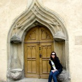 Lisa in front of the doors to the Luther House. These were a gift from Luther's wife, Catherine.